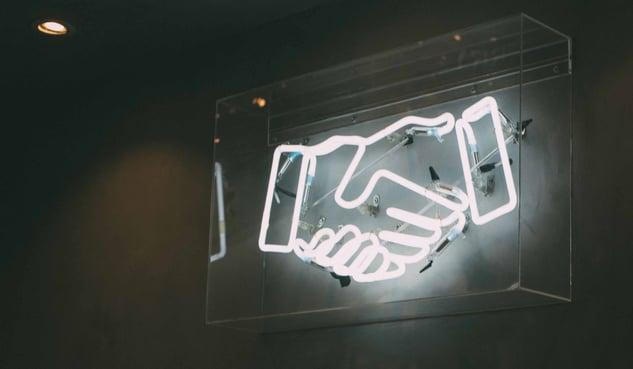 handshake-neon-charlesPH-AT5vuPoi8vc-unsplash-3000x1749-144