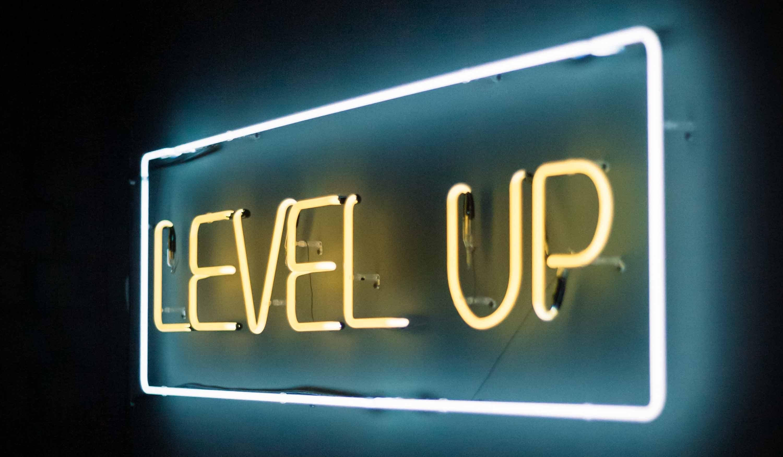 Level Up neon sign; Image by Damir Kopezhanov (emm1EBmBoj0-unsplash)